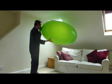 The workman blows up a jolly green giant jelly bean balloon and bursts it! Part 2