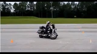 This Girl can Ride! Woman riding Harley through Police Motor Course