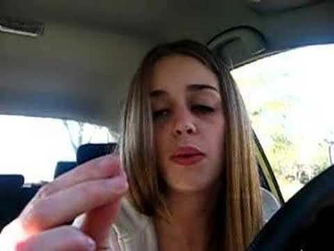 Girl In Car Amusing Herself