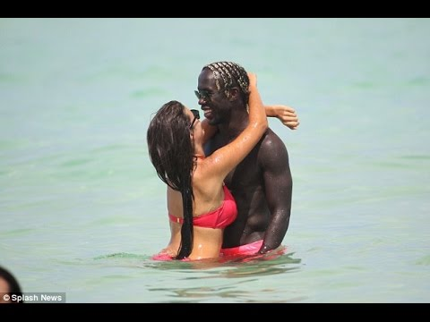 Bacary Sagna takes to the beach with wife Ludivine before beginning life at Manchester City