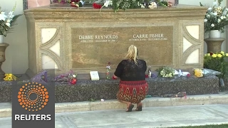 Fans remember Debbie Reynolds and Carrie Fisher at memorial