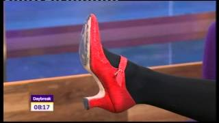 Christine Bleakley red shoes black tights