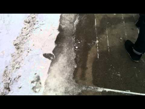 Removing thick ice from parking lot Travel Video