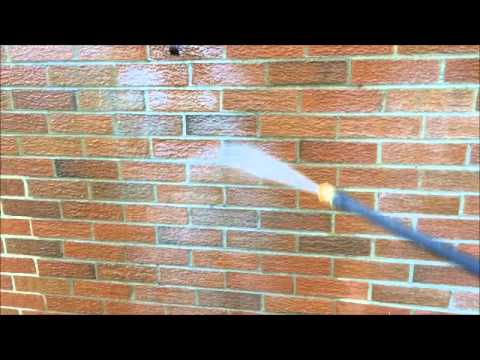 Cleaning white chalky aluminum siding oxidation from brick on an old house