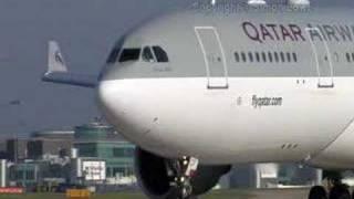 a330-200 qatar airways landing,take-off manchester airport
