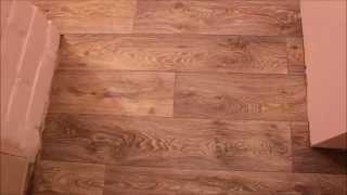 видео Как состыковать плитку и ламинат: стыковка по шагам