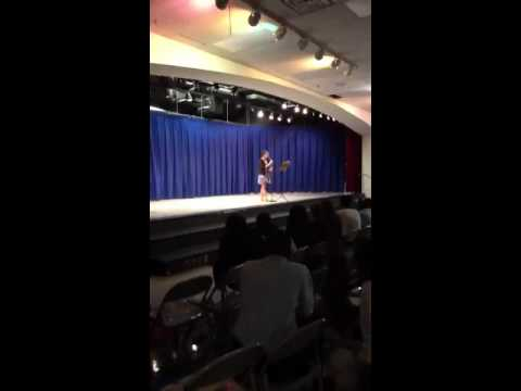 Taylor singing at The Meade Middle School talent show