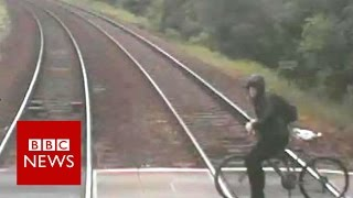 Cyclist's near miss with train released   BBC News