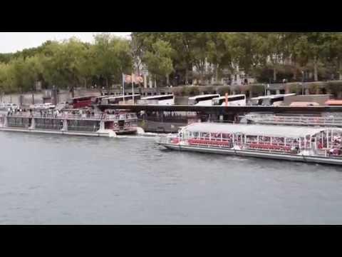River Cruise Ships Passing Eiffel Tower at Pont d'Lena Bridge
