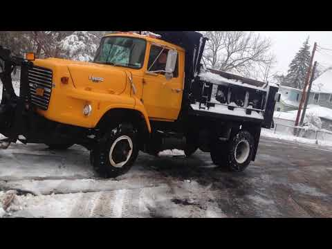Ford L9000 plowing church parking lot.