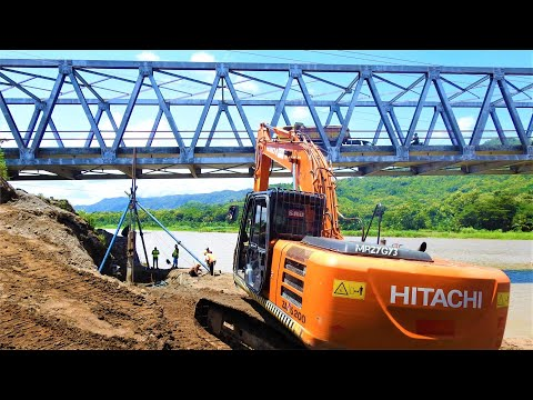 Hitachi Zaxis 200 Excavator Working With Pile Driving On The River Bridge Reinforcement