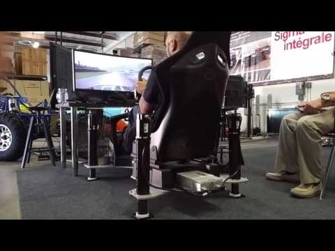 "D-BOX 6"" full motion racing simulator playing DiRT Rallycross session"