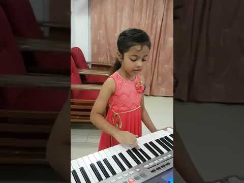 8 year old girl playing awesome casio