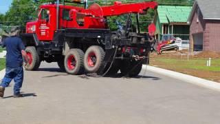 Tow truck pulling a dump truck