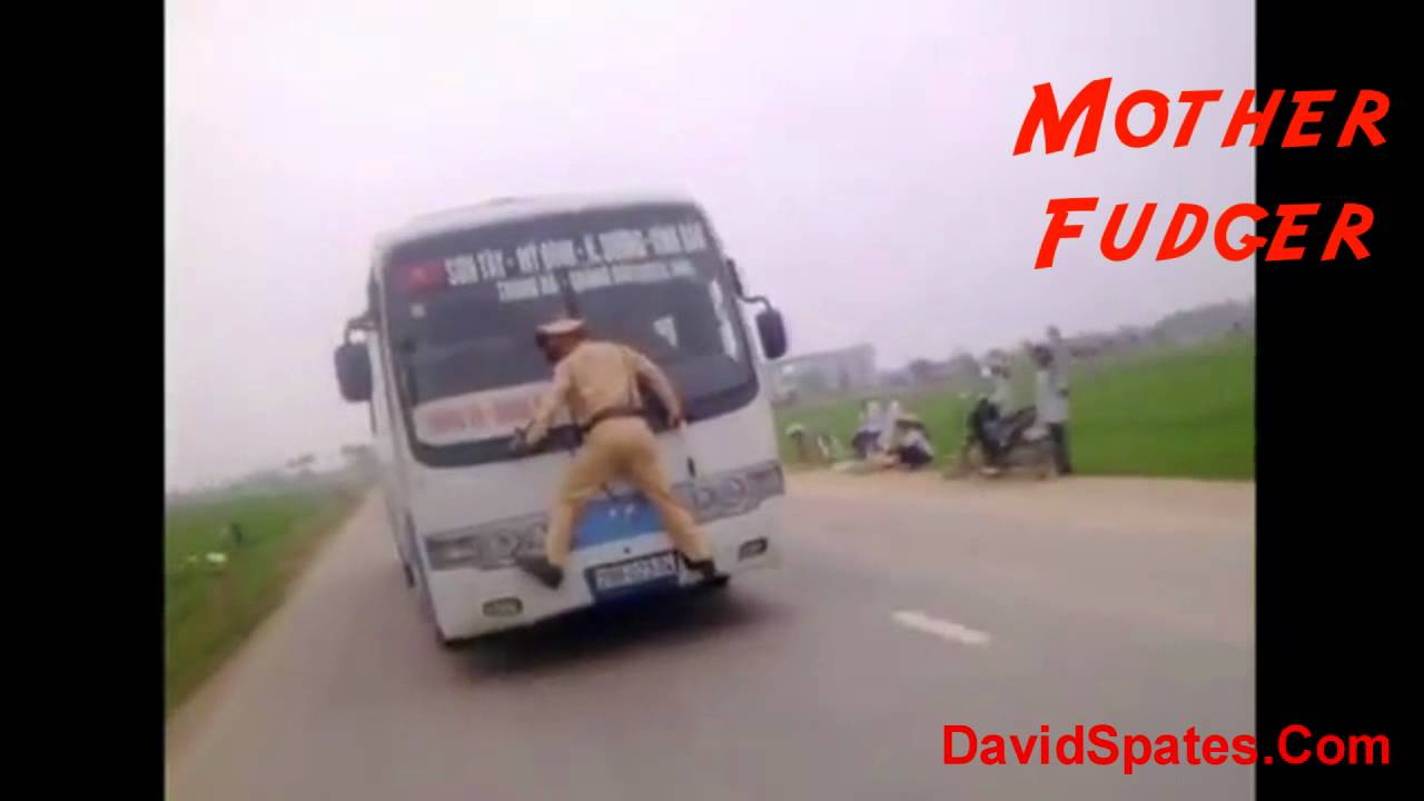 Download Vietnam Cop Clings To Speeding Bus 😮Commentary & Vid😮 ( David Spates )