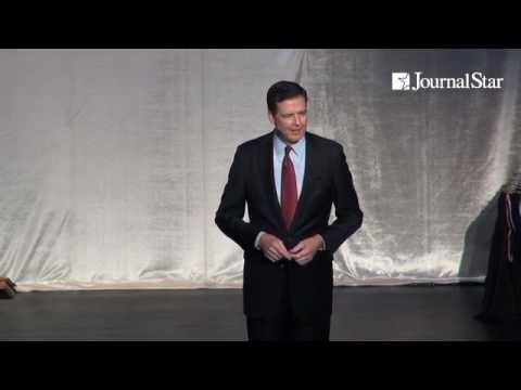 James Comey, then-Director of the FBI, addresses graduates of the ELITE Youth Program during a cerem