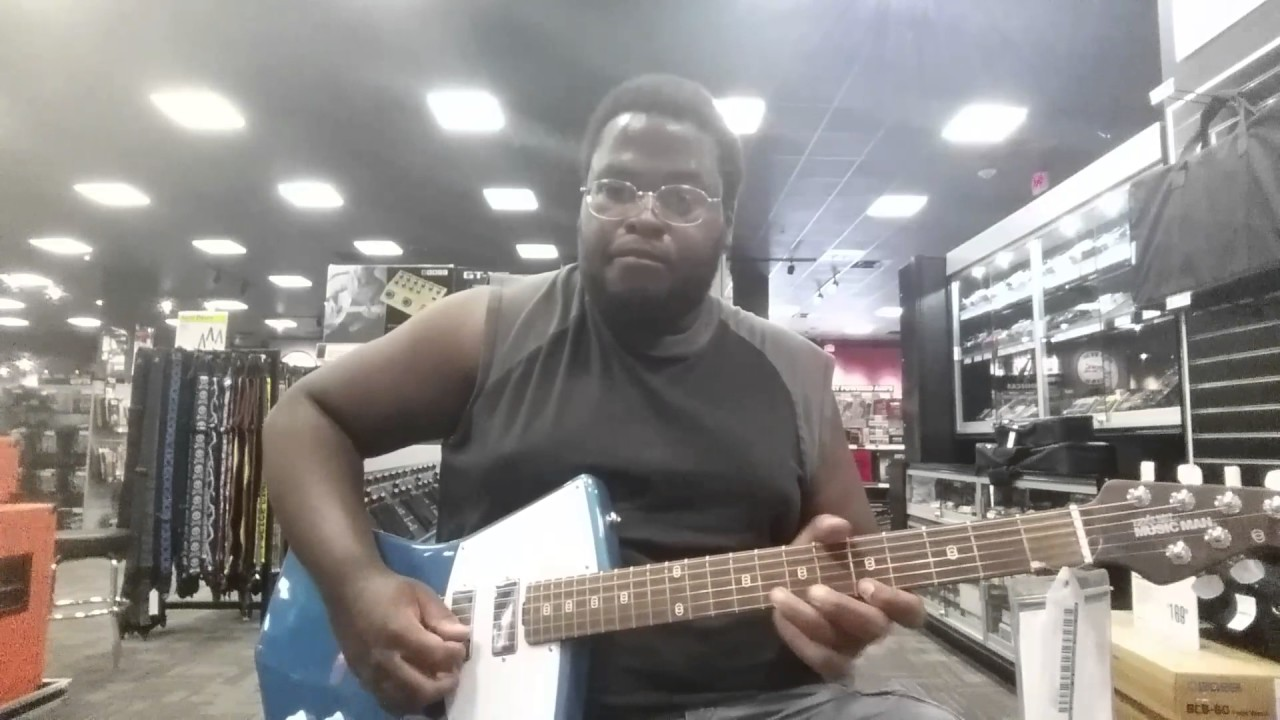 playing a music man st vincent signature model electric guitar at guitar center in las vegas. Black Bedroom Furniture Sets. Home Design Ideas