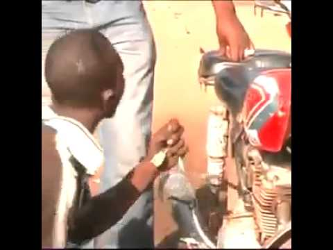 africans repair a motorcycle with special effects