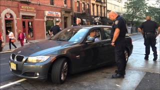 NYPD COPS GIVE NEW JERSEY MOTORIST SPEECH FOR BREAKING 5 TRAFFIC REGULATIONS ON IN MANHATTAN.