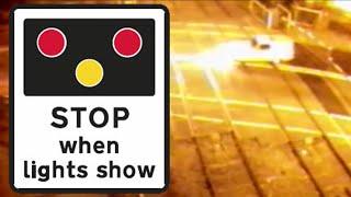 Caught on CCTV: Yellow three-wheeled van crashes through level crossing in reverse