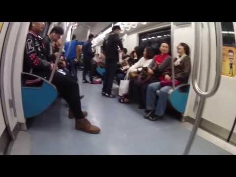 Riding a crowded subway in Beijing
