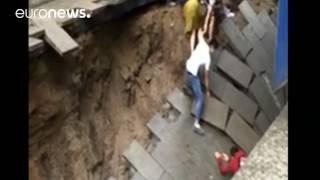 Sinkhole opens in pedestrian street, swallows 2, china