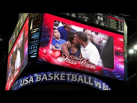 Download Obamas embrace for basketball 'kiss cam'