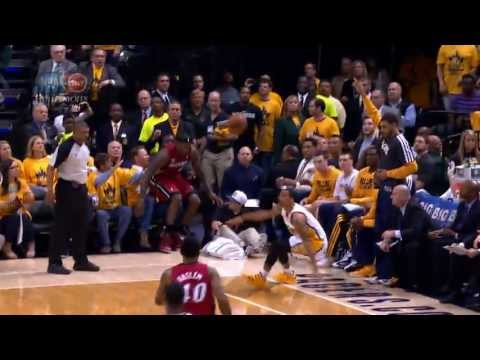 LeBron James falls into Shaq's lap!