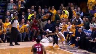 LeBron James falls into Shaq's lap!