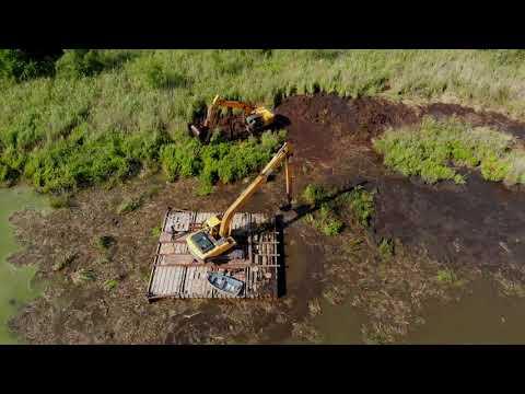 Очистка русла реки от иловых наносов