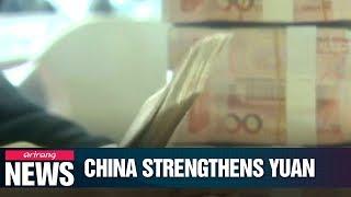 China raises nominal rate of RMB against U.S. dollar