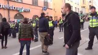 Svenska motståndsrörelsen möter motdemonstranter vid Slussen 20140412