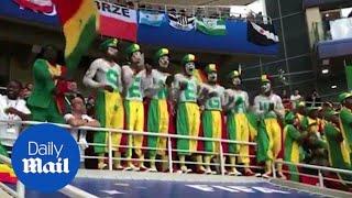Jubilant Senegal fans dance as their team win World Cup game
