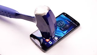 Is This The World's Most Indestructible Phone?(Not only did I drop test the new Motorola Droid Turbo 2 but I also gave it a few slams with the good old hammer. Did it survive to tell the story? FACEBOOK: ..., 2015-11-01T02:23:43.000Z)