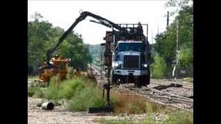 Hi-rail truck crane unloads old ties from Union Pacific siding