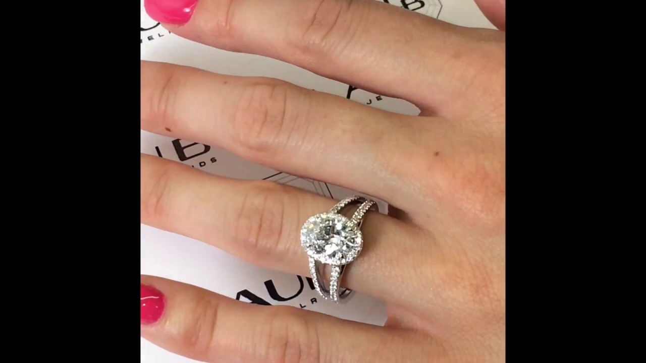 1 74 carat oval halo engagement ring in wide pave split