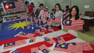 Flag making family gets busy nearing Merdeka