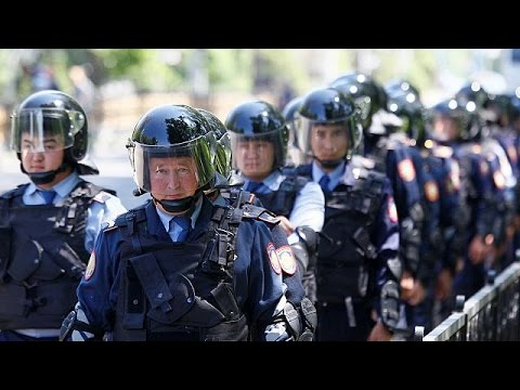 Kazakh police break up anti-government protests