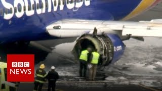 Panic as jet engine rips apart midair - BBC News