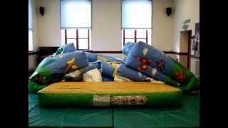 Inflating a large bouncy castle ready for hire in Wales