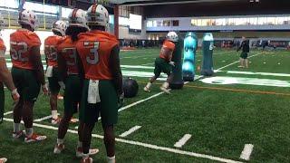 Shaq Quarterman goes through drills during Miami Hurricanes practice