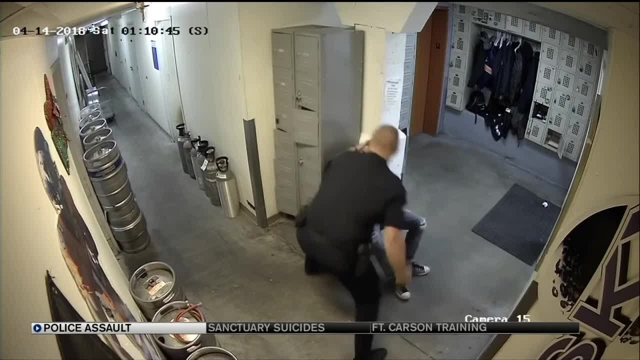 Download Video shows Denver officer knocking handcuffed man unconscious