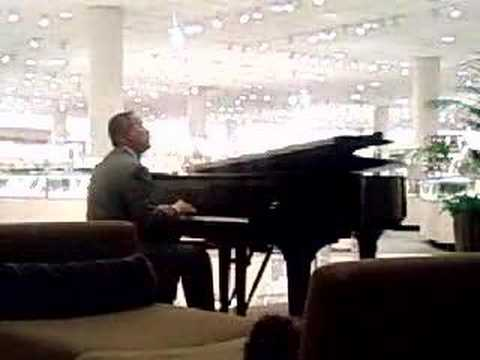 bare guy playing piano