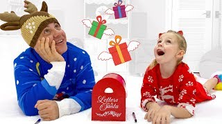Nastya and dad open gifts from Santa Claus