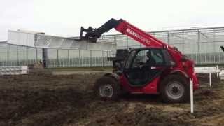 Manitou MLT 940 4x4 fork lift truck moving stuff through deep mud