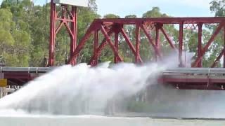 jet-boat-sprays-bridge
