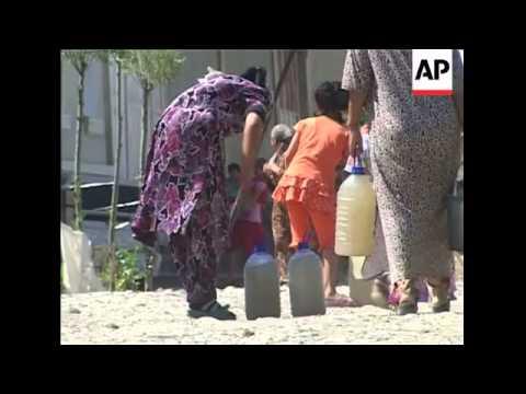 Ethnic Uzbeks vote in Osh, Internally Displaced camp, ADDS OCSE observers