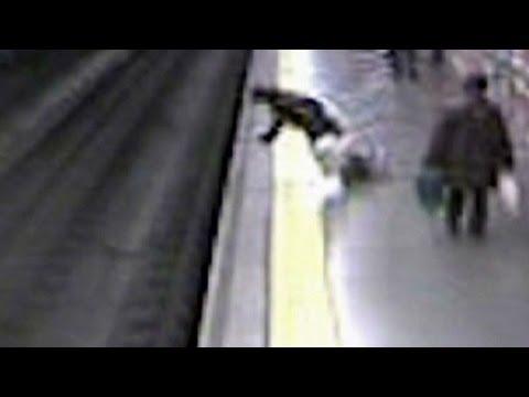 Fainting woman falls on train tracks