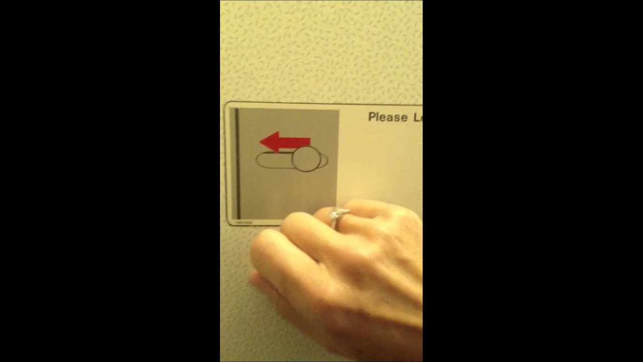 How to unlock the door of the airplane bathroom and get