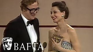 Audrey Hepburn presents Michael Caine with his BAFTA in 1984
